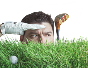 Golfer searching for a lost golf ball